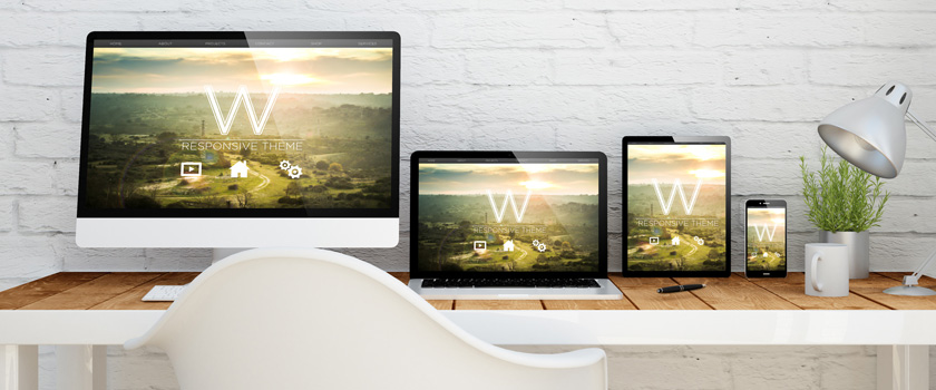 Multiple devices depicting responsive design and landing pages