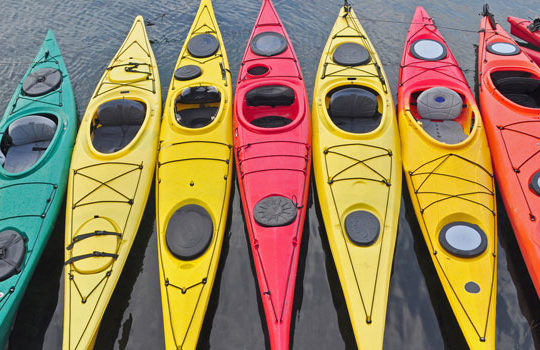 Colorful kayaks lined up in a row